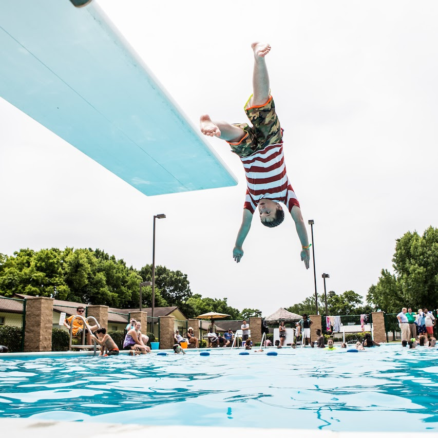 youth jumping of a diving board
