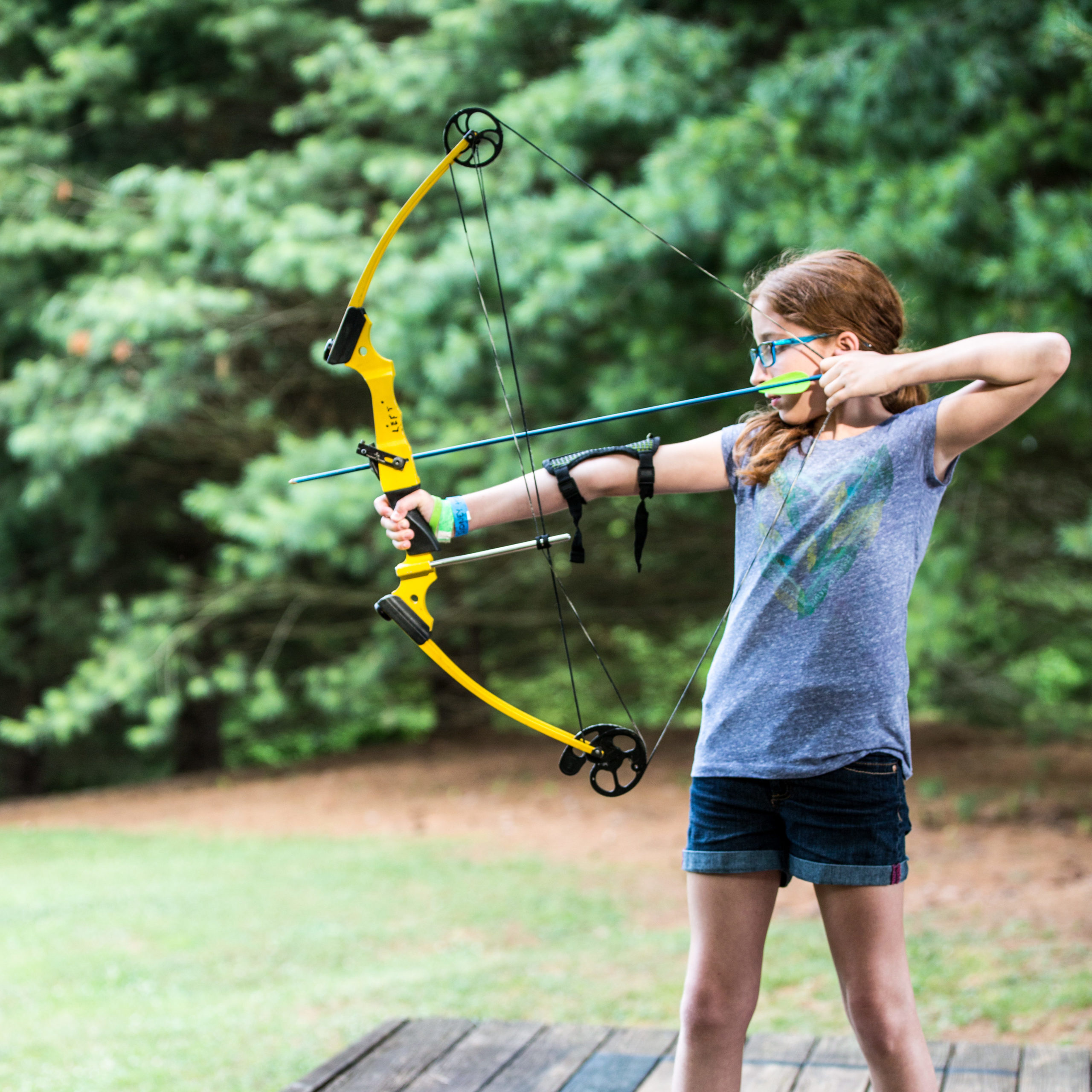 youth shooting bow