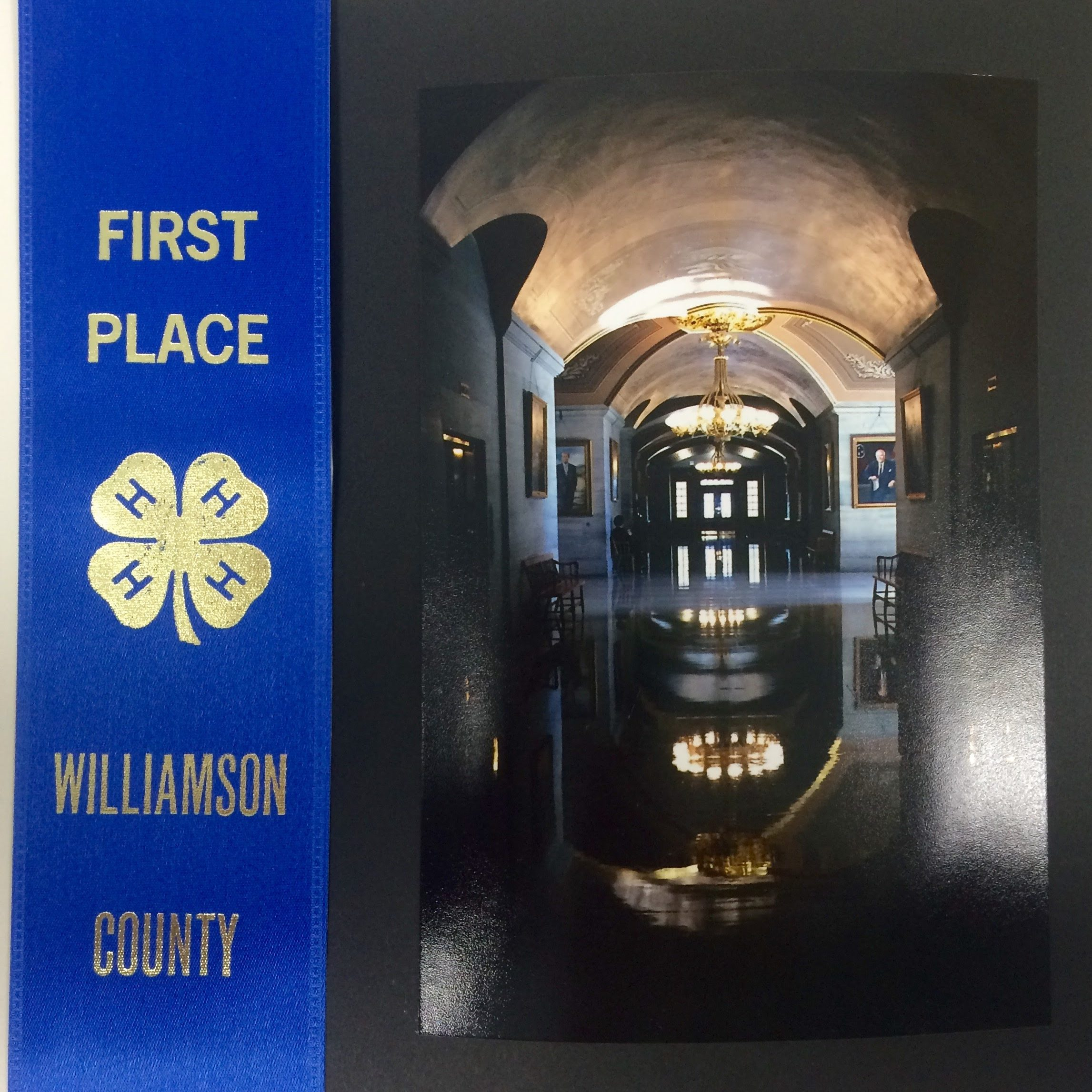 photo with a first place ribbon
