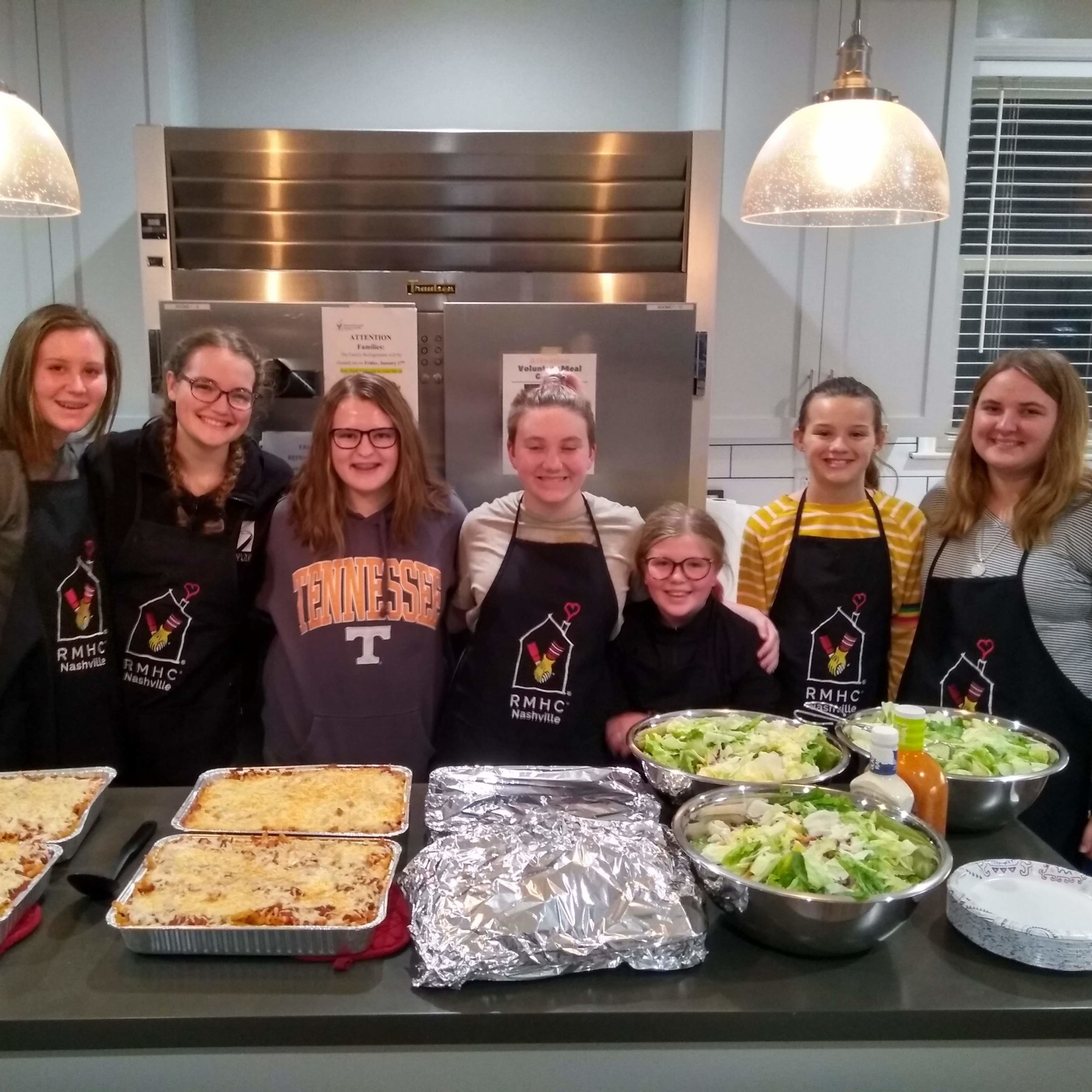 culinary youth standing by food