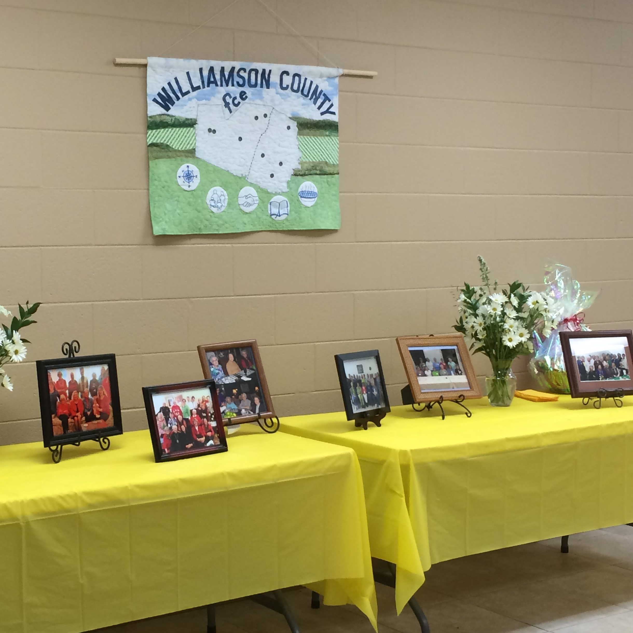 Table showing pictures and awards