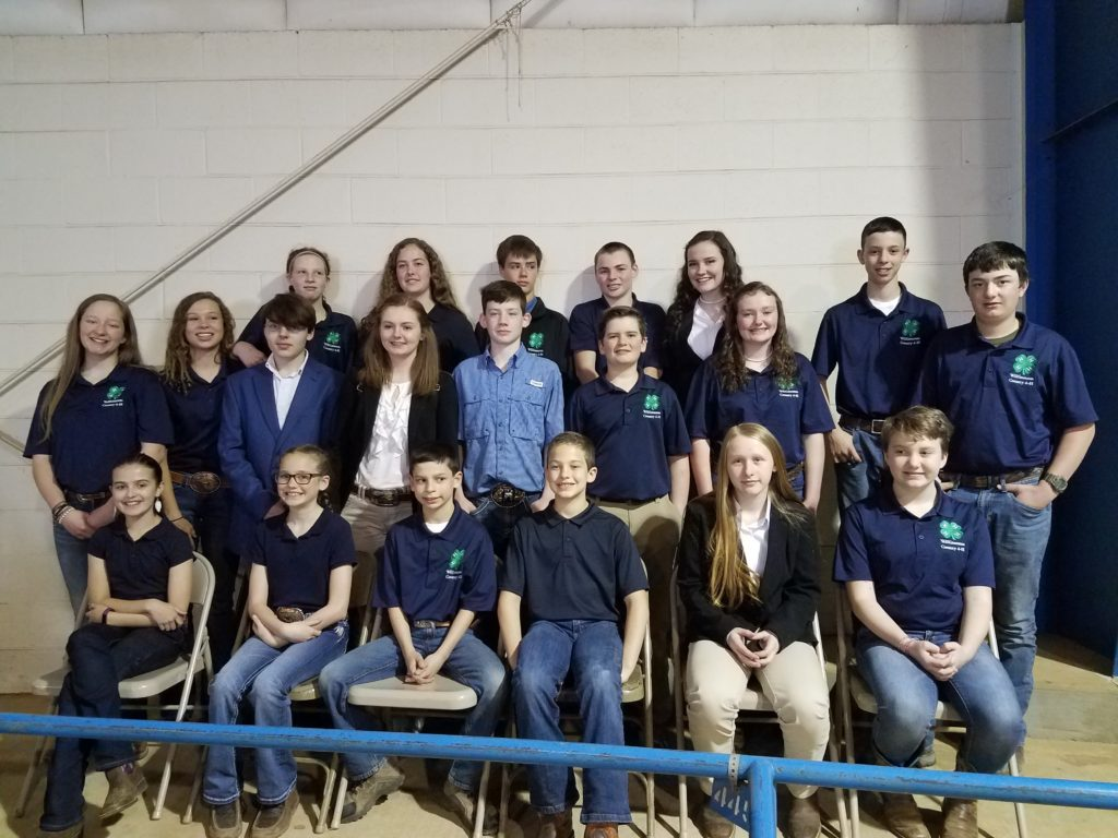4-H livestock judging team members in 4-H polo shirts