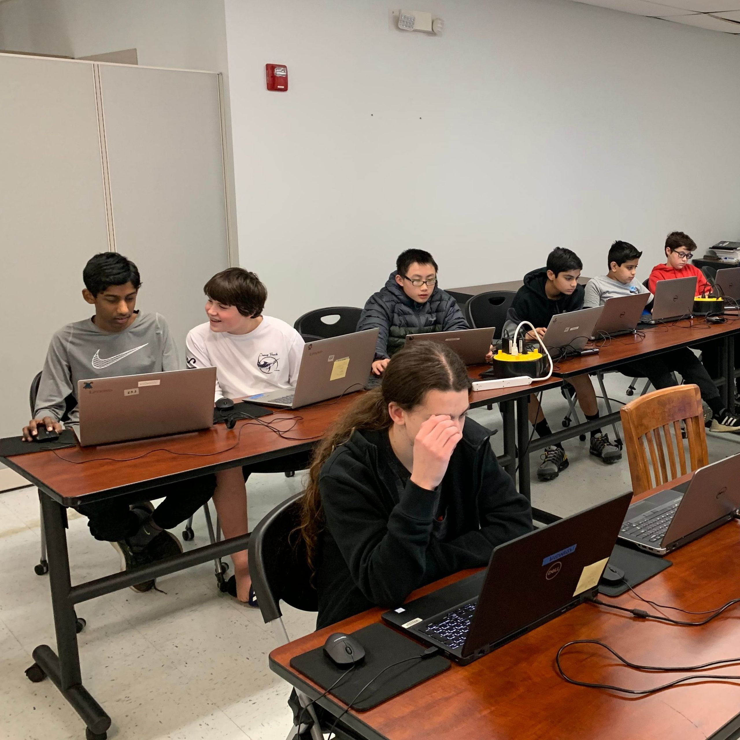 youth working on computers for micro;bit class
