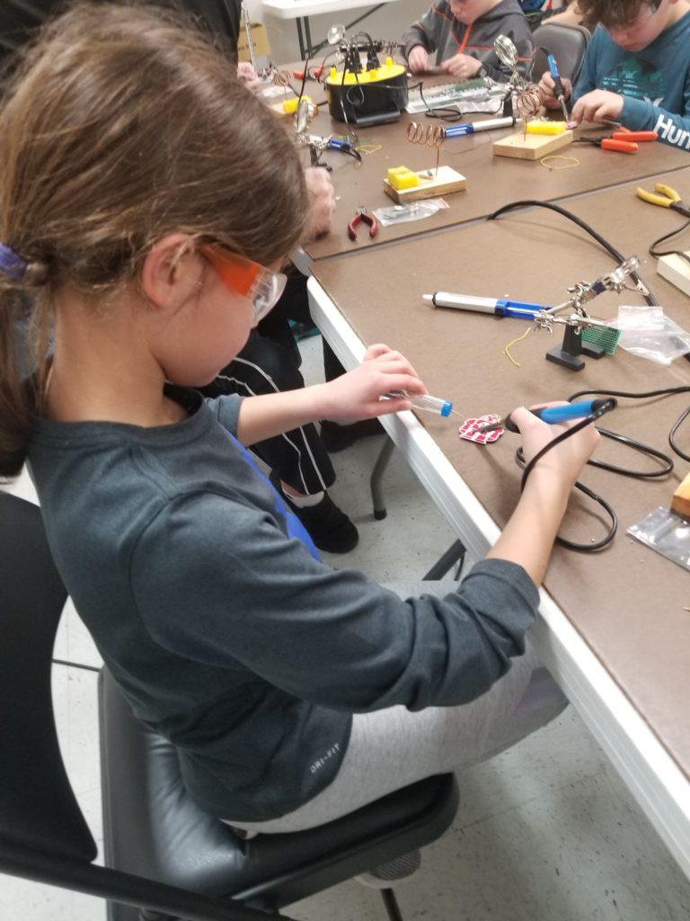 student soldering in STEM Fun class
