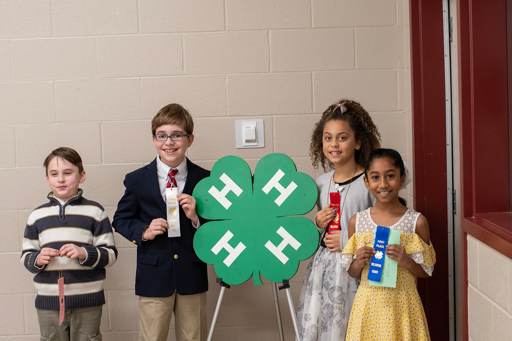 Children with ribbons from 4-H public speaking contest